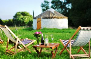 Glamping summer deckchairs prosecco yurts